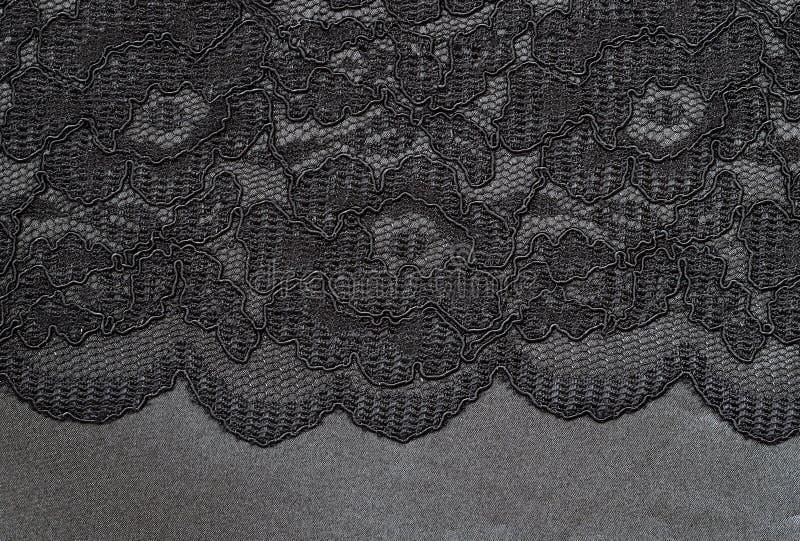 Μαύρη δαντέλλα στο μετάξι στοκ εικόνες με δικαίωμα ελεύθερης χρήσης