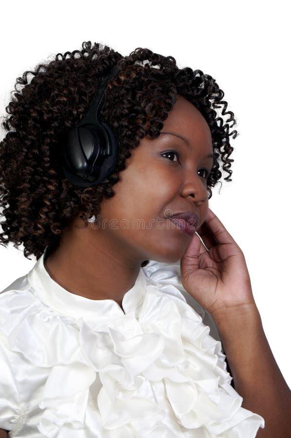 μαύρη γυναίκα ακουστικών στοκ εικόνα με δικαίωμα ελεύθερης χρήσης