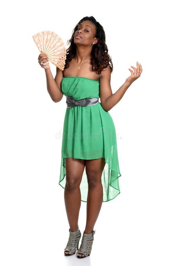 Μαύρη γυναίκα με έναν ανεμιστήρα στοκ φωτογραφία