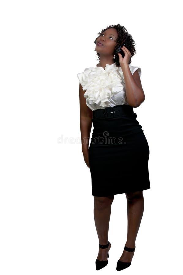 Μαύρη γυναίκα με τα ακουστικά στοκ εικόνες
