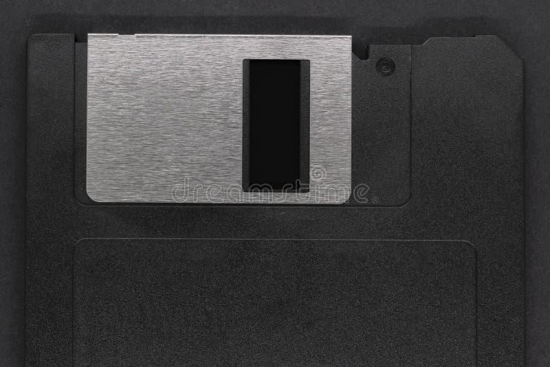 Μαύρη δισκέτα στο μαύρο υπόβαθρο στοκ εικόνα με δικαίωμα ελεύθερης χρήσης