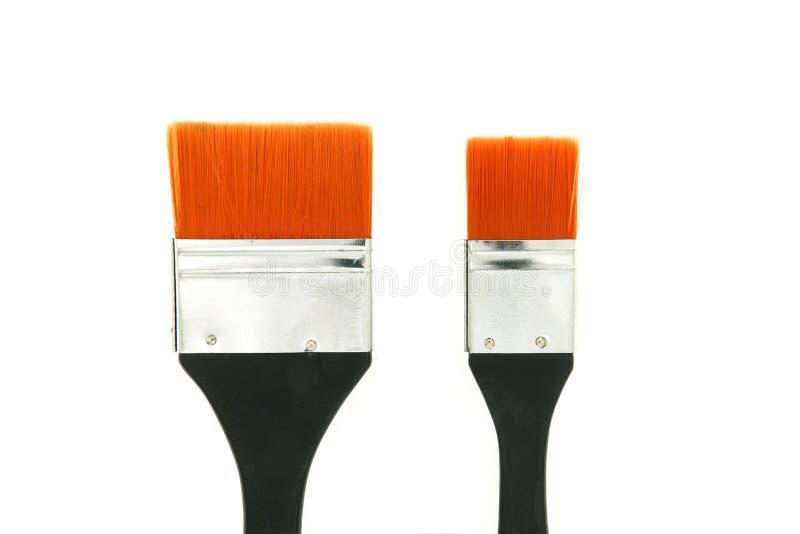 μαύρη λαβή βουρτσών 2 χρωμάτων, πορτοκαλιές σκληρές τρίχες στοκ εικόνες