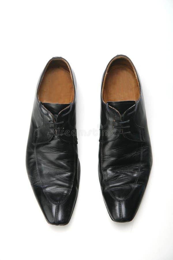 Μαύρη μπότα στο άσπρο υπόβαθρο στοκ φωτογραφίες