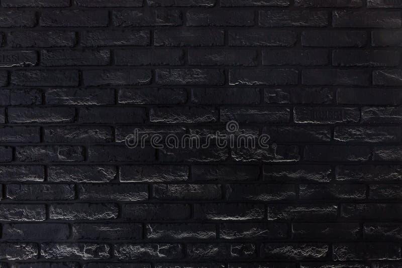 Μαύρη παλαιά λεπτομερής τουβλότοιχος σύσταση για το υπόβαθρο στοκ εικόνα