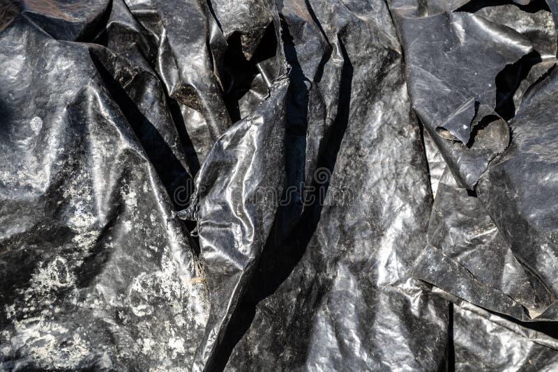 Μαύρη σύσταση επιφάνειας φύλλων αλουμινίου πλαστική στοκ εικόνες με δικαίωμα ελεύθερης χρήσης