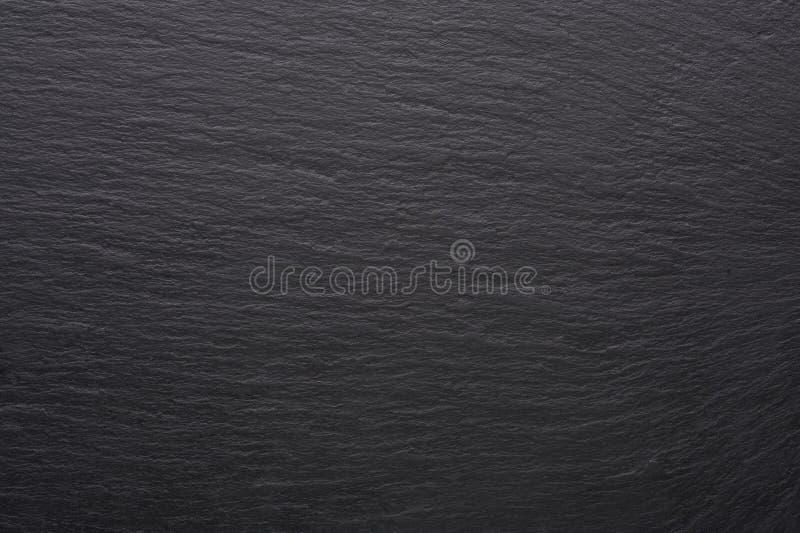 Μαύρη σύσταση κεραμιδιών πετρών Κενή μαύρη επιφάνεια με το διάστημα αντιγράφων στοκ φωτογραφία