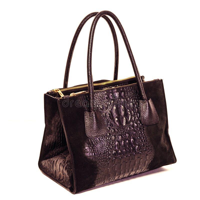 Μαύρη τσάντα δέρματος γυναικών ` s που απομονώνεται στο άσπρο υπόβαθρο στοκ εικόνες με δικαίωμα ελεύθερης χρήσης