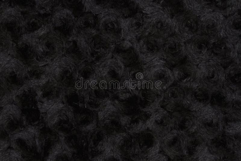 Μαύρος αυξήθηκε κατασκευασμένο υπόβαθρο υφάσματος βελούδου στοκ φωτογραφία με δικαίωμα ελεύθερης χρήσης