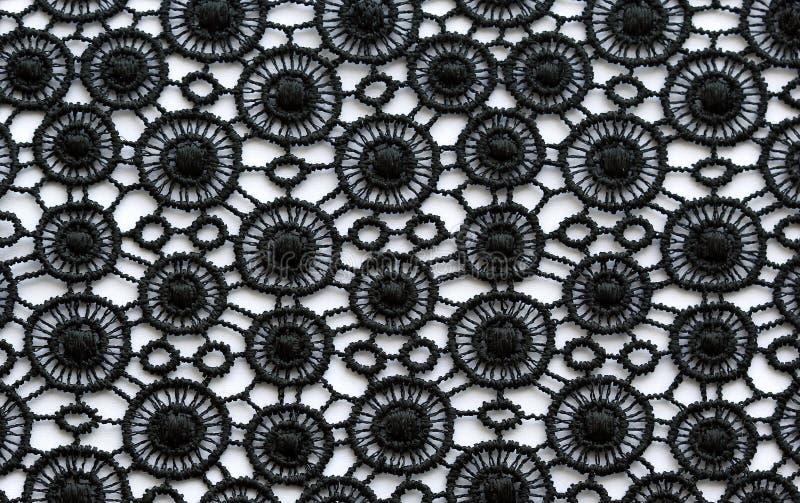 Μαύρος λουλουδιών μακρο πυροβολισμός σύστασης δαντελλών υλικός στοκ εικόνες