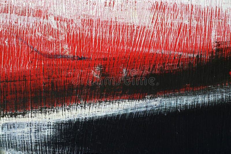 Μαύρο, άσπρο, κόκκινο ακρυλικό χρώμα στην επιφάνεια μετάλλων brushstroke στοκ φωτογραφία