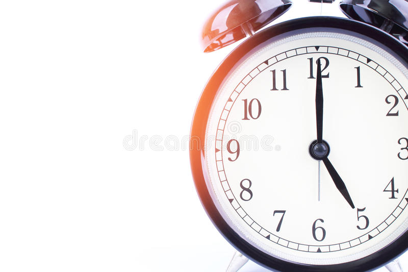 Μαύρο αναδρομικό ξυπνητήρι με απομονωμένο το ακουστικό υπόβαθρο στο wh στοκ φωτογραφίες