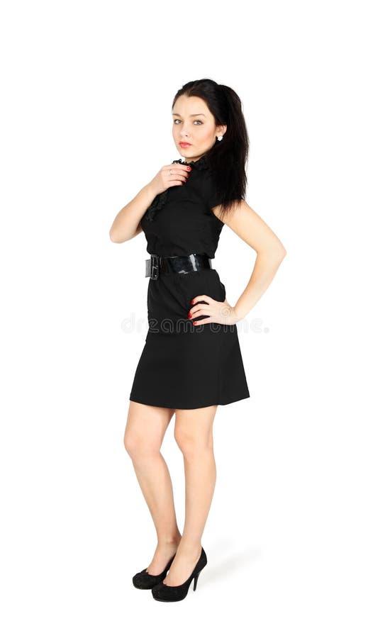 μαύρο κορίτσι φορεμάτων που φορά απότομα τις νεολαίες στοκ εικόνα