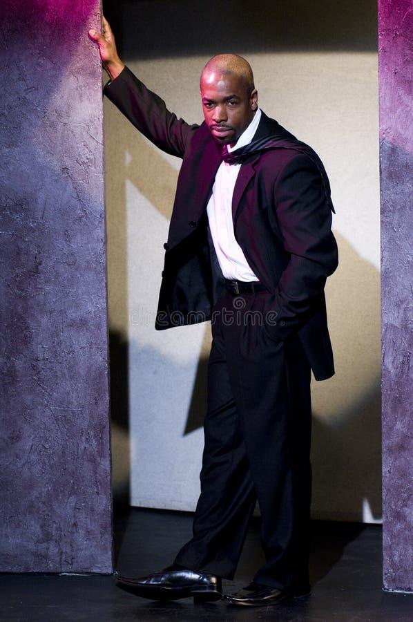 μαύρο κοστούμι πορτρέτου & στοκ εικόνα
