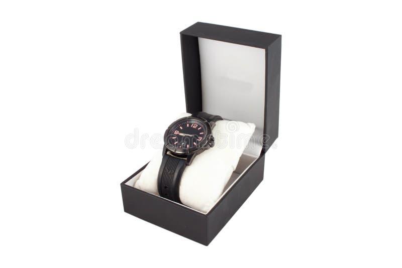 Μαύρο κουτί με το ρολόι στο άσπρο υπόβαθρο στοκ εικόνες