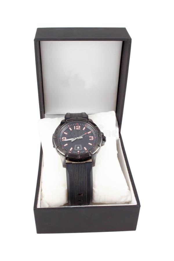 Μαύρο κουτί με το ρολόι στο άσπρο υπόβαθρο στοκ φωτογραφίες
