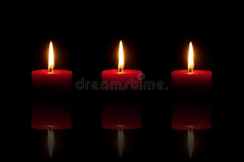 μαύρο κόκκινο τρία κεριών α&n στοκ εικόνες