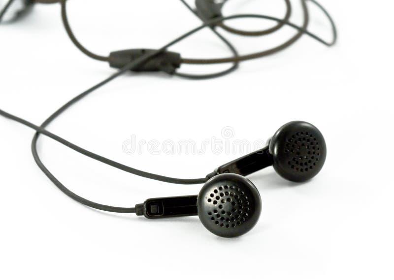 μαύρο λευκό ακουστικών στοκ φωτογραφίες