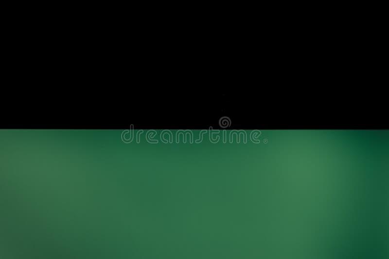 Μαύρο μισό πράσινο κενό διάστημα σύστασης υποβάθρου στοκ φωτογραφίες με δικαίωμα ελεύθερης χρήσης