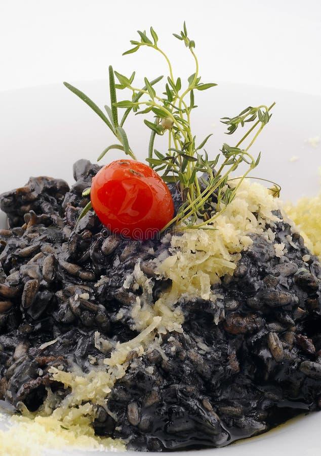 Μαύρο πιάτο risotto στοκ φωτογραφία