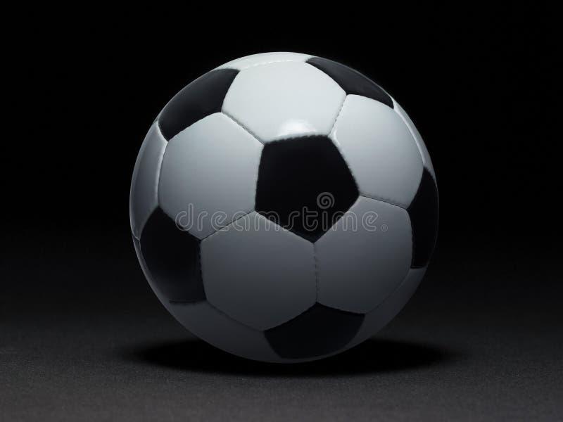 μαύρο ποδόσφαιρο σφαιρών ανασκόπησης στοκ φωτογραφία
