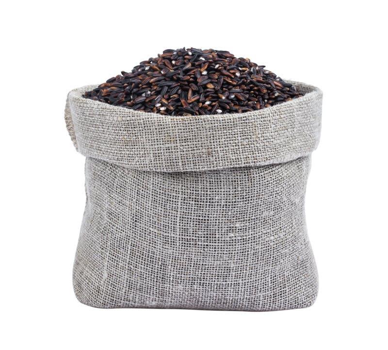 Μαύρο ρύζι burlap στην τσάντα που απομονώνεται στο λευκό στοκ φωτογραφίες με δικαίωμα ελεύθερης χρήσης