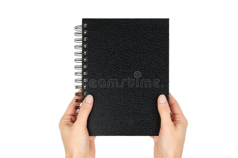 Μαύρο σημειωματάριο για να γράψει ή να επισύρει την προσοχή στη σπείρα υπό εξέταση, που απομονώνεται στο άσπρο υπόβαθρο στοκ εικόνα με δικαίωμα ελεύθερης χρήσης