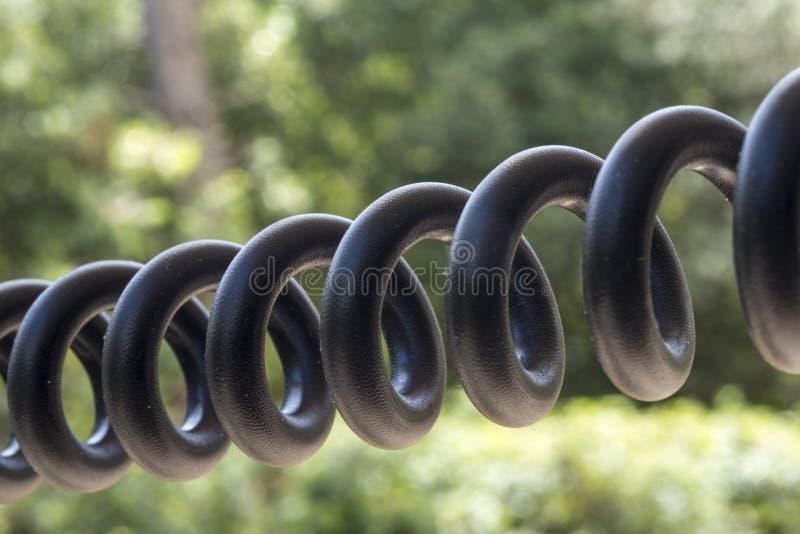 μαύρο σπειροειδές τηλέφωνο καλωδίων στοκ εικόνες