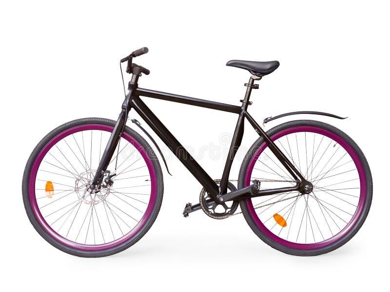 Μαύρο σταθερό αστικό ποδήλατο με τη βιολέτα whells που απομονώνεται με το ψαλίδισμα στοκ εικόνα με δικαίωμα ελεύθερης χρήσης