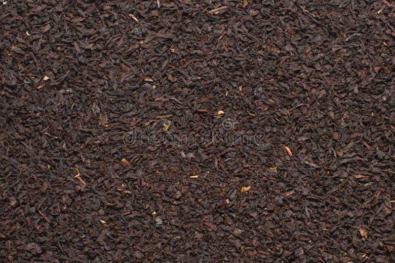 Μαύρο υπόβαθρο σύστασης φύλλων τσαγιού βουνών στοκ εικόνες