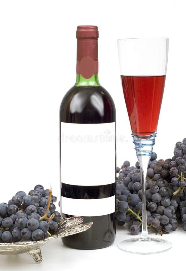 μαύρο bottleful κρασί σταφυλιών στοκ φωτογραφία με δικαίωμα ελεύθερης χρήσης