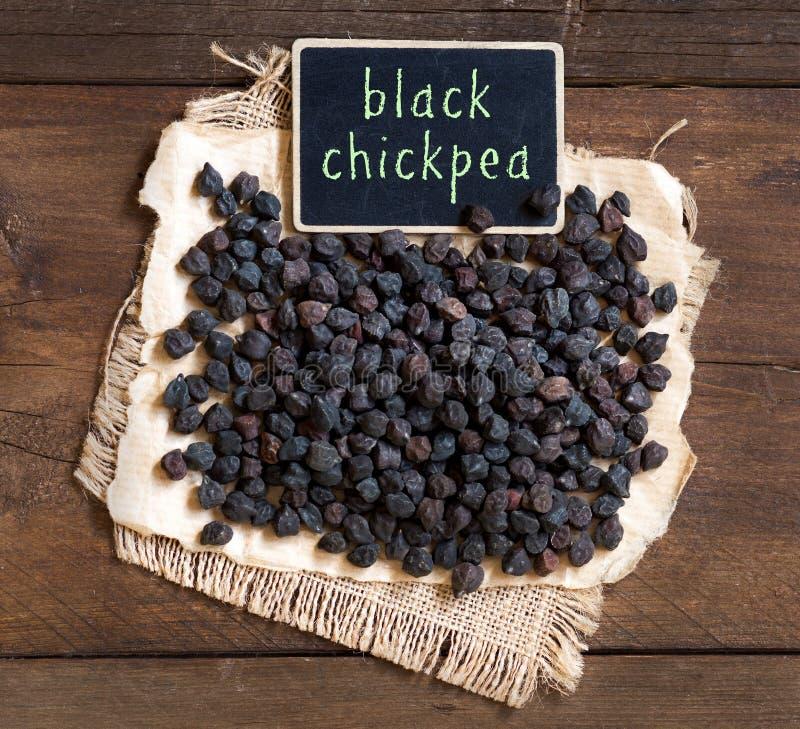 Μαύρο Chickpea με έναν μικρό πίνακα κιμωλίας στοκ φωτογραφίες με δικαίωμα ελεύθερης χρήσης