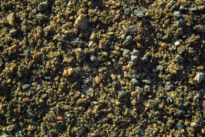 Μεγάλα μόρια της λεπτής βρώμικης άμμου, αμμοχάλικο, γη στοκ φωτογραφίες