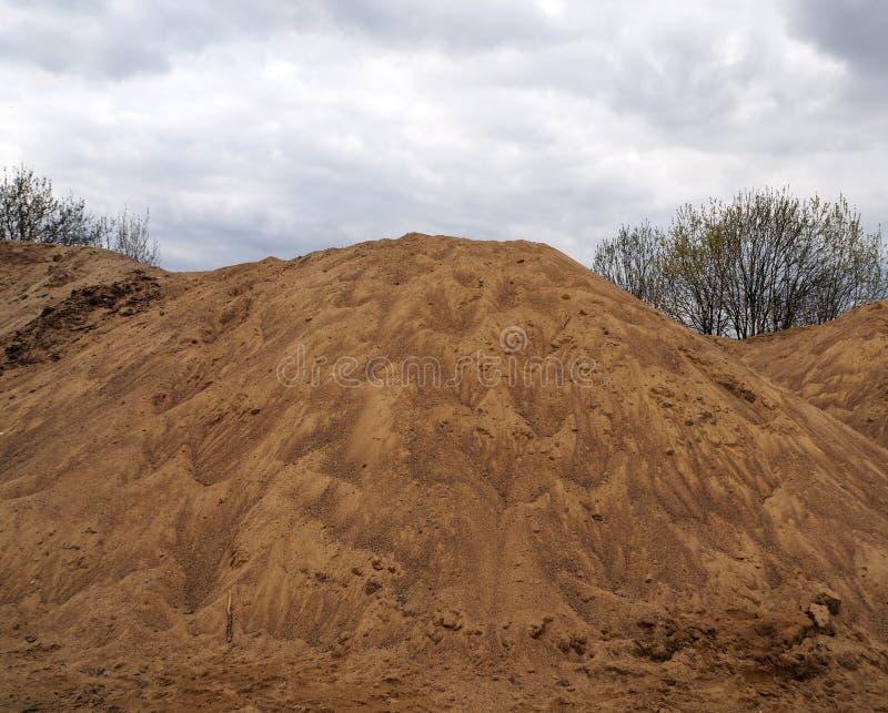 Μεγάλοι σωροί της άμμου κατασκευής στοκ εικόνα