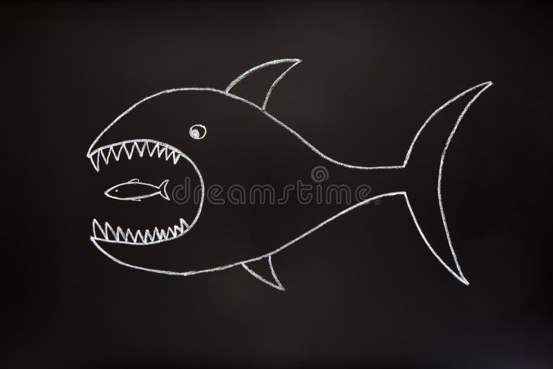 μεγάλος τρώει τα ψάρια ένα μ& στοκ φωτογραφία με δικαίωμα ελεύθερης χρήσης