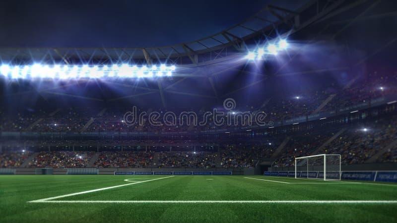 Μεγάλο γήπεδο ποδοσφαίρου που φωτίζεται από τα επίκεντρα και την κενή πράσινη χλόη στοκ εικόνα με δικαίωμα ελεύθερης χρήσης