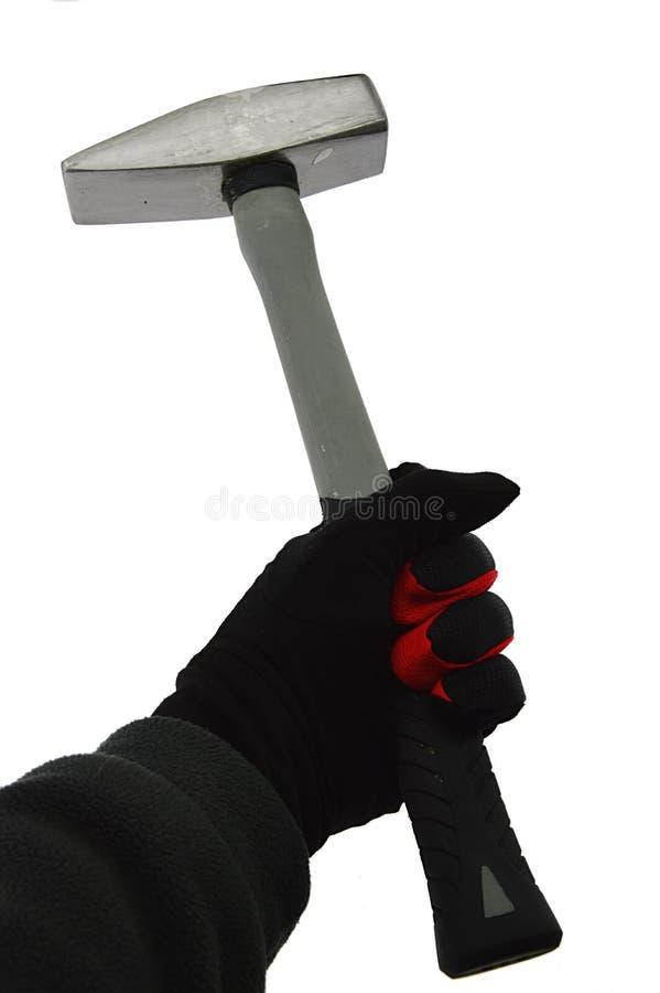 Μεγάλο σφυρί κλειδαράδων που κρατιέται στο αριστερό χέρι στο λεπτό μαύρο νάυλον/spandex το γάντι με την κόκκινη περίληψη, άσπρο υ στοκ εικόνα