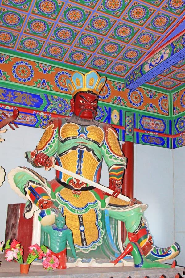 Μεγάλο θεϊκό γλυπτό βασιλιάδων τέσσερα στην αίθουσα σε έναν ναό στοκ φωτογραφίες