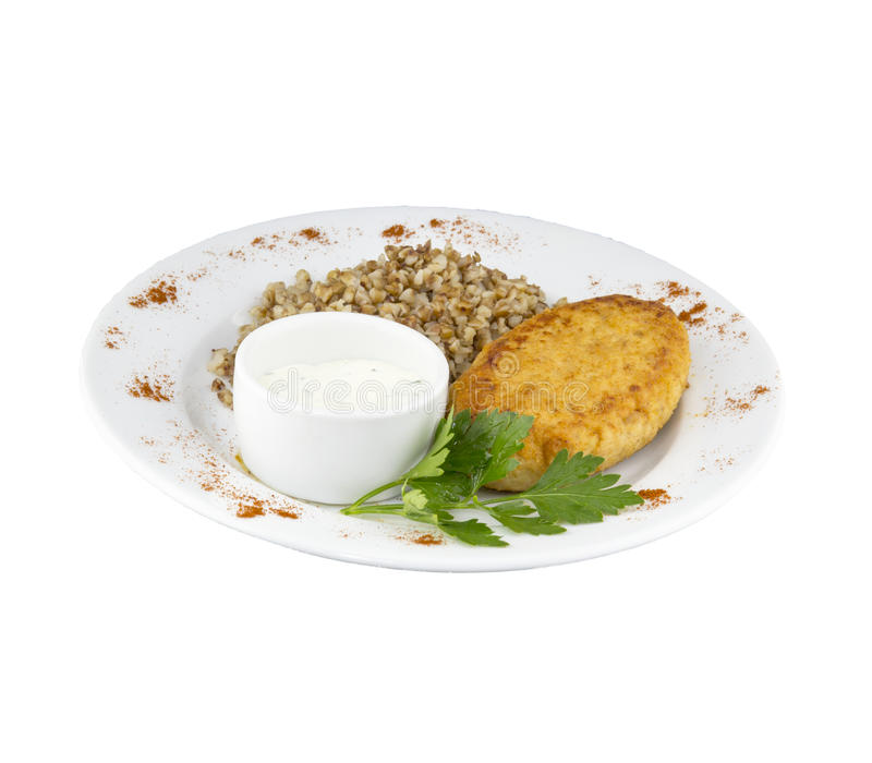 Μεγάλο cutlet κοτόπουλου με τη σάλτσα και το φαγόπυρο στοκ εικόνες