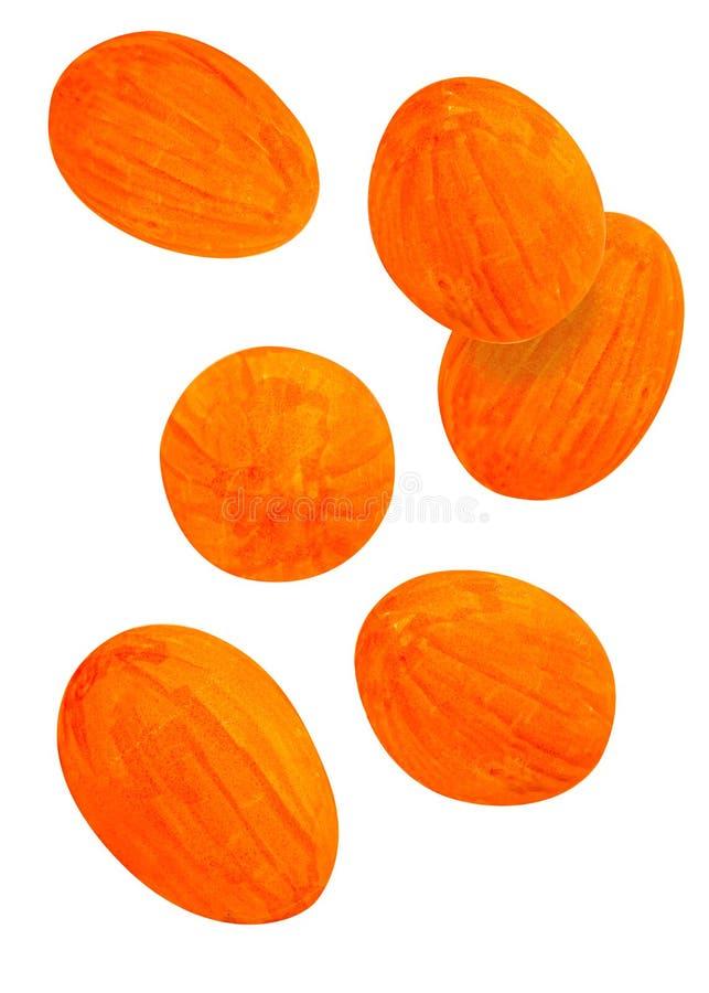 Μειωμένα πορτοκαλιά αυγά Πάσχας που απομονώνονται στο άσπρο υπόβαθρο στοκ φωτογραφία με δικαίωμα ελεύθερης χρήσης