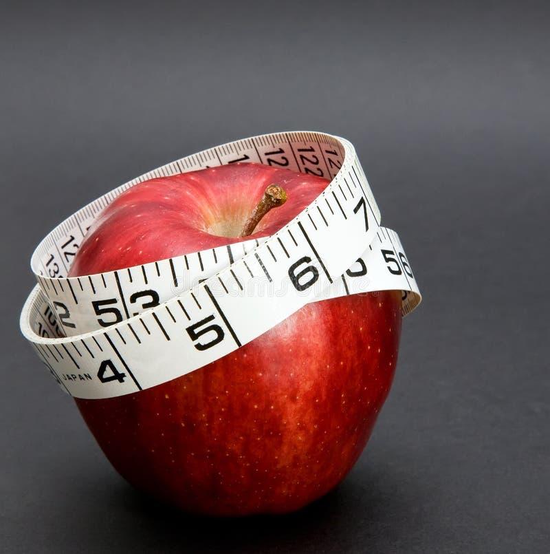 μειωτής s φύσης μέτρησης μήλων στοκ εικόνα