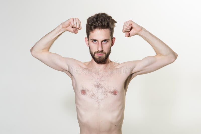 Μεμβρανοειδή ευκίνητα όπλα νεαρών άνδρων Λεπτή man do sport κατάρτιση Παρακινητική αύξηση μυών με τα αναβολικά στεροειδή Αυξήσεις στοκ φωτογραφίες