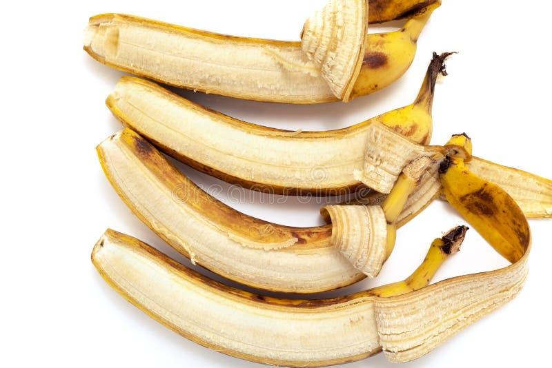 Μερικώς ξεφλουδισμένη μπανάνα τέσσερα που βρίσκεται στην κάθετη σειρά στοκ φωτογραφία με δικαίωμα ελεύθερης χρήσης