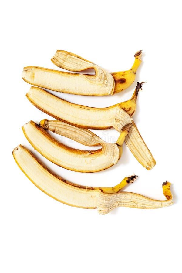 Μερικώς ξεφλουδισμένη μπανάνα τέσσερα που βρίσκεται στην κάθετη σειρά στοκ εικόνες