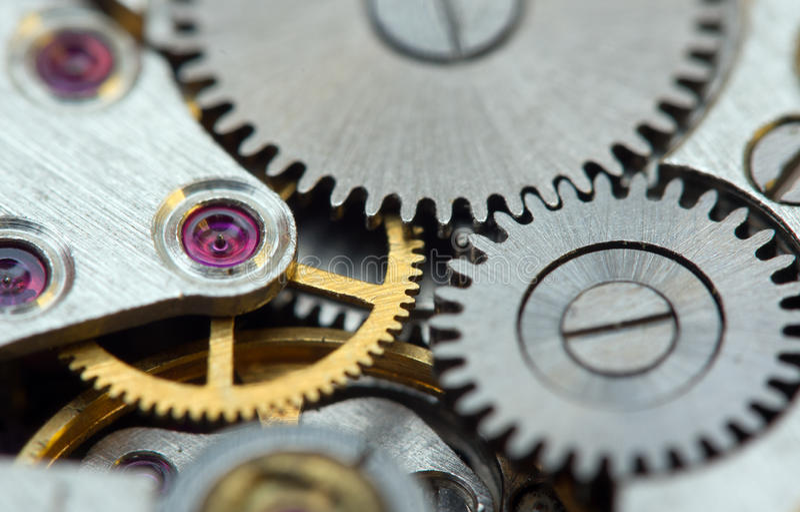 Μεταλλικό υπόβαθρο με cogwheels μετάλλων ένας μηχανισμός Μακροεντολή στοκ εικόνες με δικαίωμα ελεύθερης χρήσης