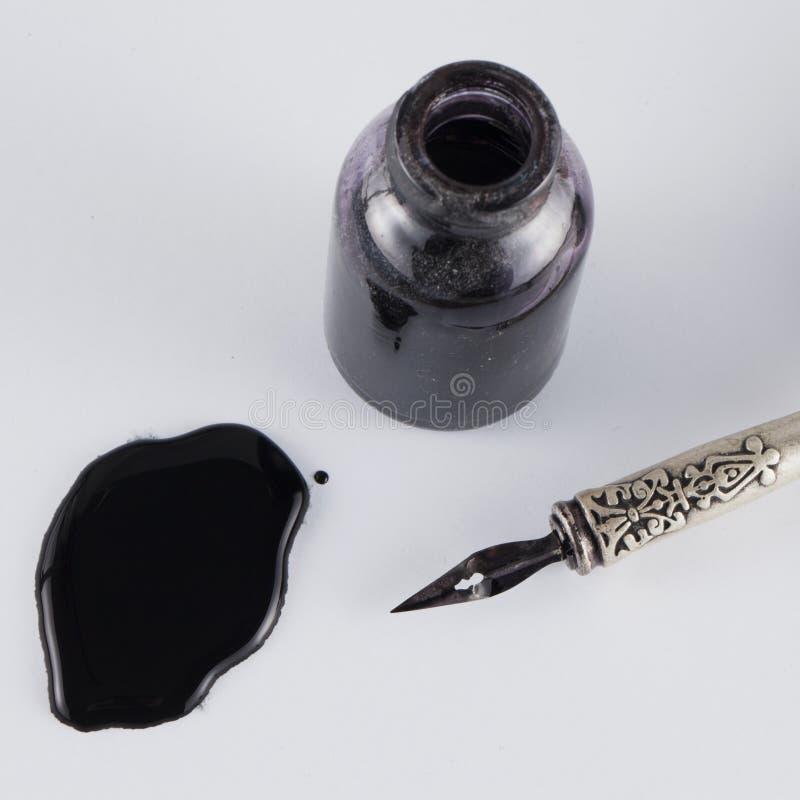 Μελάνι και στυλός στοκ εικόνες