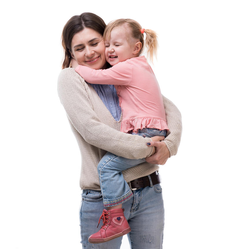 Μητέρα με λίγη κόρη στο αγκάλιασμα όπλων της στοκ εικόνα