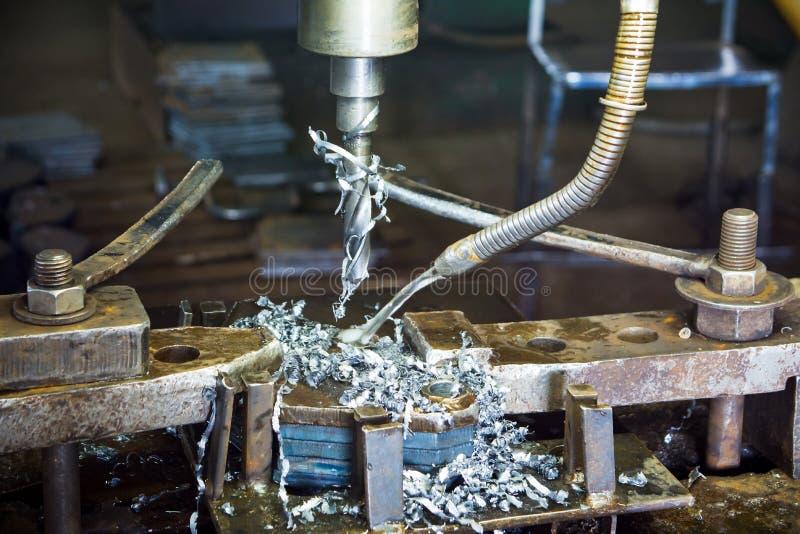 Μηχανή διατρήσεων ανοξείδωτου που δροσίζεται από το νερό στοκ φωτογραφίες