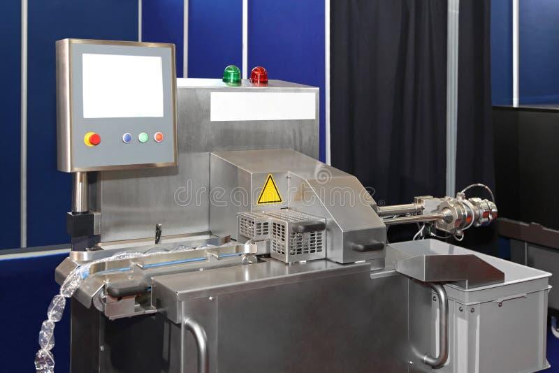Μηχανή συσκευασίας κρέατος στοκ φωτογραφία