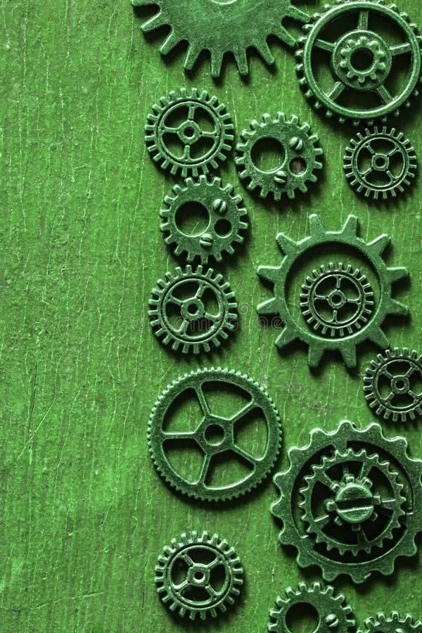 Μηχανικές ρόδες εργαλείων βαραίνω Steampunk πράσινες στοκ εικόνες