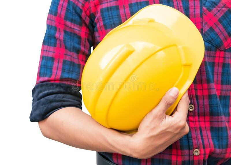 Μηχανικών λαβής κίτρινη ασφάλειας έννοια κατασκευής κρανών πλαστική που απομονώνεται στο άσπρο υπόβαθρο στοκ εικόνες